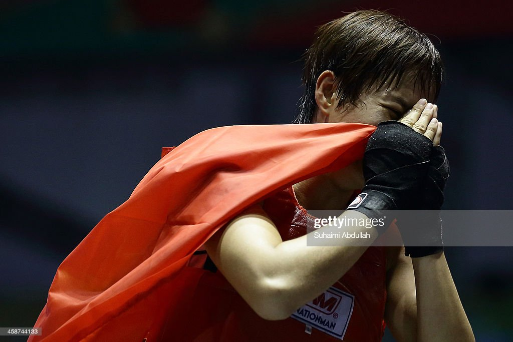 Yen Ly Bui of Vietnam reacts after losing to Grace of Myanmar during the female muay 51kg division weight bout at the Wunna Theikdi Boxing Centre during the 2013 SEA Games on December 21, 2013 in Nay Pyi Taw, Burma.