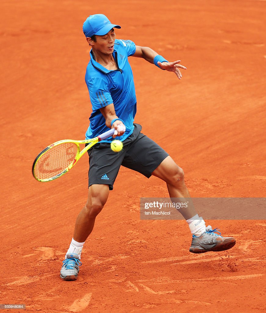 Yen-Hsmen of Chinese Taipei plays a shot during the Men's Singles first round match against Novak Djokovic of Serbia on day three of the 2016 French Open at Roland Garros on May 24, 2016 in Paris, France .