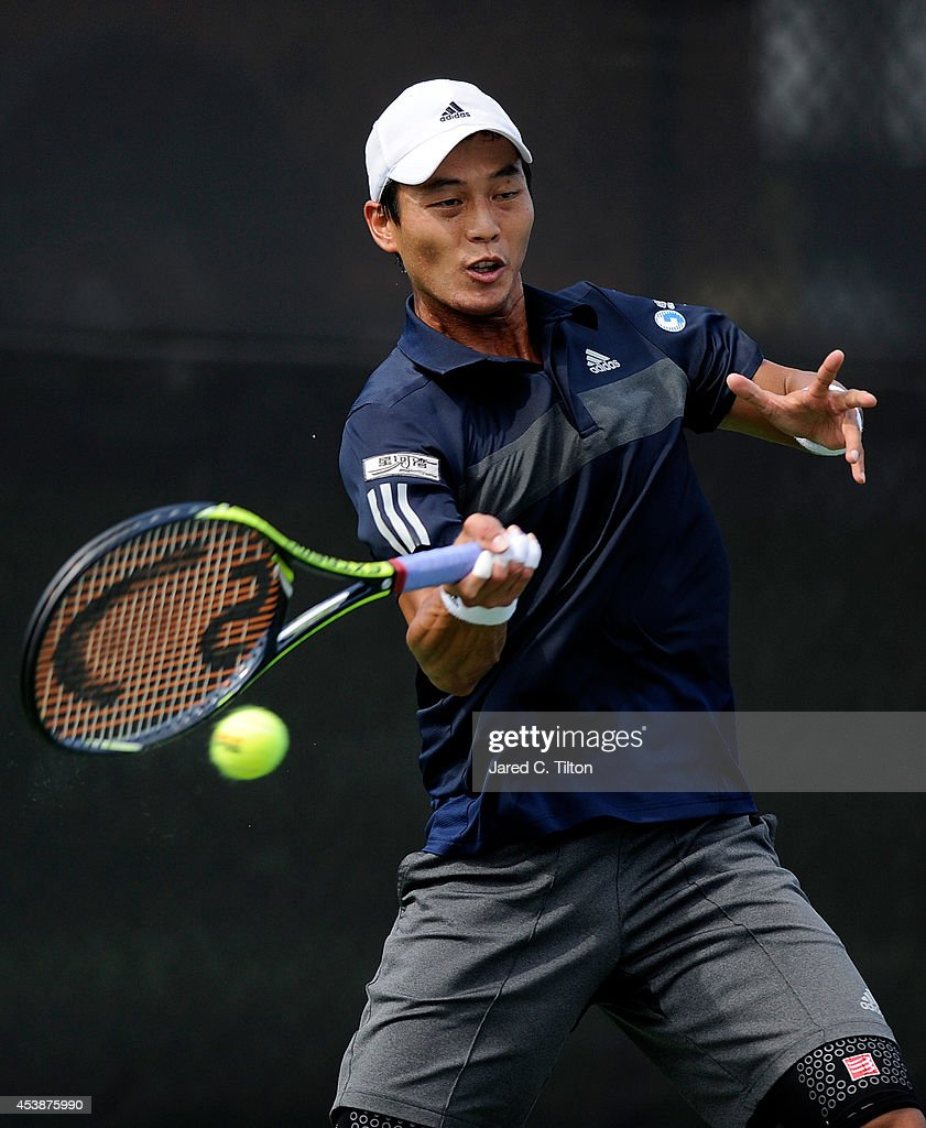 Yen-Hsun Lu of Chinese Taipei returns a shot from Marcel Granollers of Spain during the Winston-Salem Open at Wake Forest University on August 20, 2014 in Winston Salem, North Carolina.