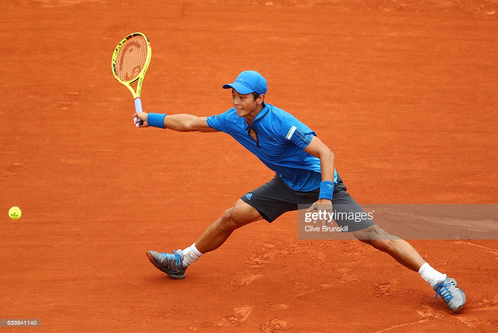 Yen-Hsun Lu of Taipei stretches for a forehand during the Men's Singles first round match against Novak Djokovic of Serbia on day three of the 2016 French Open at Roland Garros on May 24, 2016 in Paris, France.