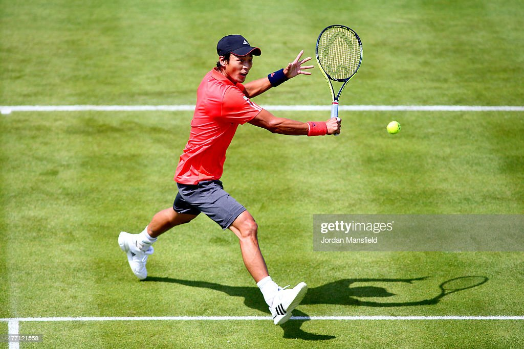 Yen-Hsun Lu of Taiwan plays a backhand during his Qualification match of the Aegon Championships against Denis Istomin of Uzbekistan at Queens Club on June 14, 2015 in London, England.