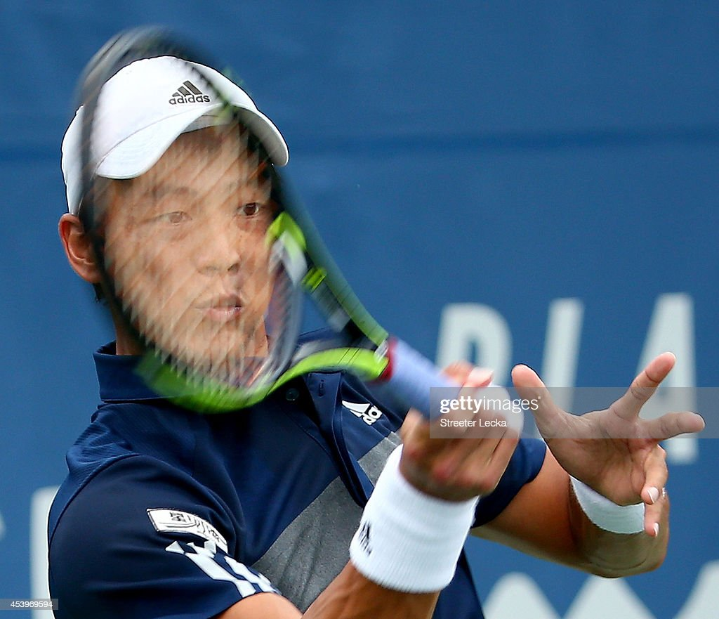 Yen-Hsun Lu of Tawain returns a shot to Lukas Rosol of the Czech Republic during the men's semifinal match of the Winston-Salem Open at Wake Forest University on August 22, 2014 in Winston Salem, North Carolina.