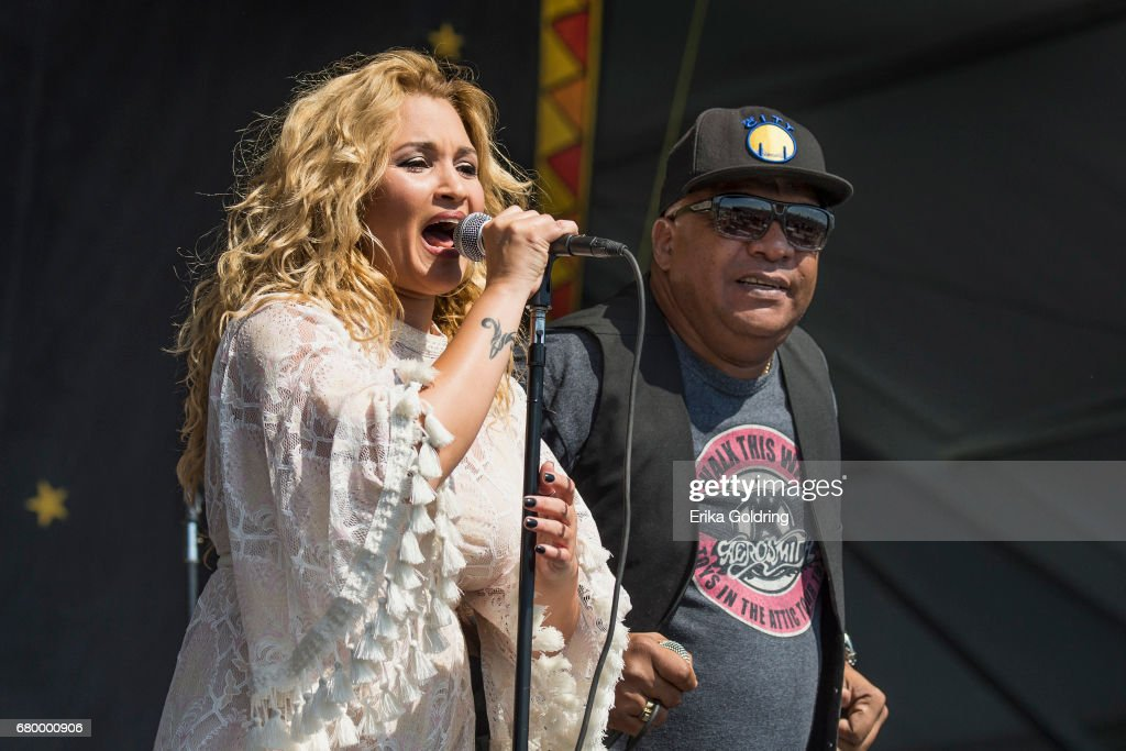 Yenisel Valdes and Abdel Rasalps of Los Van Van perform at the 2017 New Orleans Jazz & Heritage Festival at Fair Grounds Race Course on May 6, 2017 in New Orleans, Louisiana.