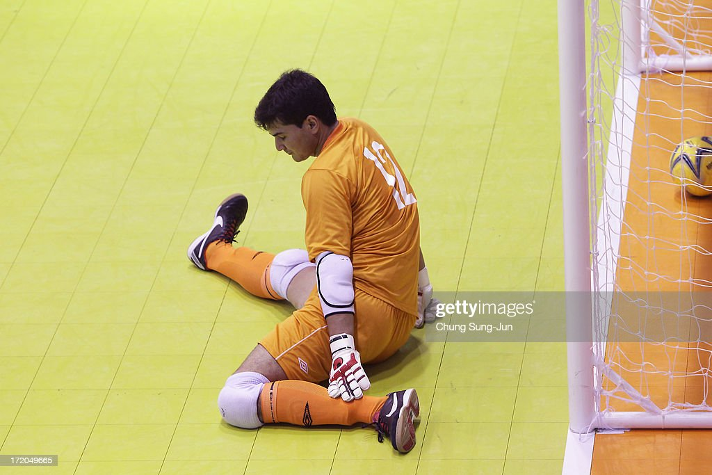 Yenish Ashyrov #12 of Turkmenistan reacts during a Futsal, Men's team group play stage at Dongbu Student's Gygymnasium during day three of the 4th Asian Indoor & Martial Arts Games on July 1, 2013 in Incheon, South Korea.