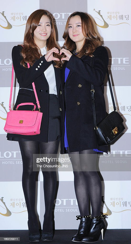 Yenny and Hye-Rim of Wondergirls attend Sun's Wedding at lotte hotel on January 26, 2013 in Seoul, South Korea.