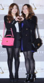 Yenny and HyeRim of Wondergirls attend Sun's Wedding at lotte hotel on January 26 2013 in Seoul South Korea