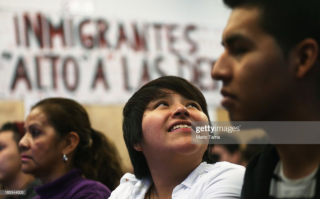 Yenny Quispe (C), who is from Peru and received her Green Card two-days ago, smiles during a watch party of President Barack Obama's speech on immigration on January 29, 2013 in the Queens borough of New York City. Obama called for immigration reform and a 'pathway to citizenship' for the nation's 11 million undocumented immigrants.