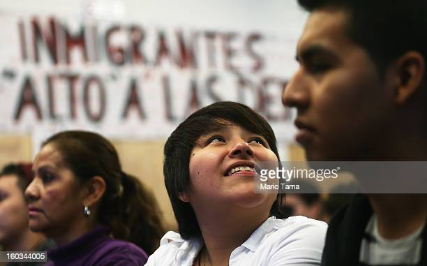 Yenny Quispe who is from Peru and received her Green Card twodays ago smiles during a watch party of President Barack Obama's speech on immigration...