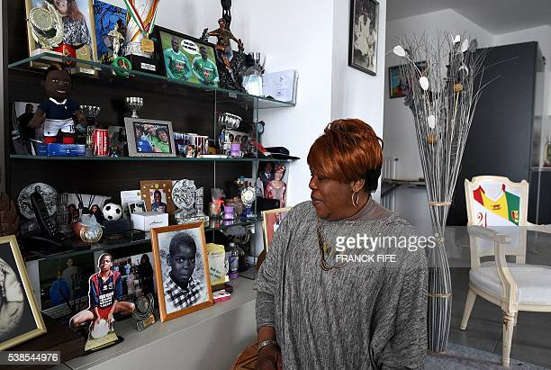 Yeo Moriba the mother of footballer Paul Pogba poses in with medals trophies and photos on March 16 2016 in Bussy Saint Georges east of Paris Yeo...