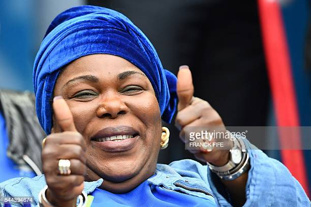 Yeo Moriba the mother of France's midfielder Paul Pogba gives the thumbs up as she waits for the start of the Euro 2016 quarterfinal football match...