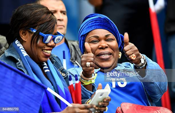Yeo Moriba the mother of France's midfielder Paul Pogba gives the thumbs up prior to the Euro 2016 quarterfinal football match between France and...