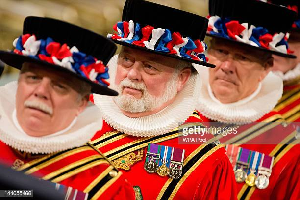 Yeoman of the Guard wear traditional uniform as they wait for Queen Elizabeth II to walk through the Royal Gallery in the Palace of Westminsterduring...