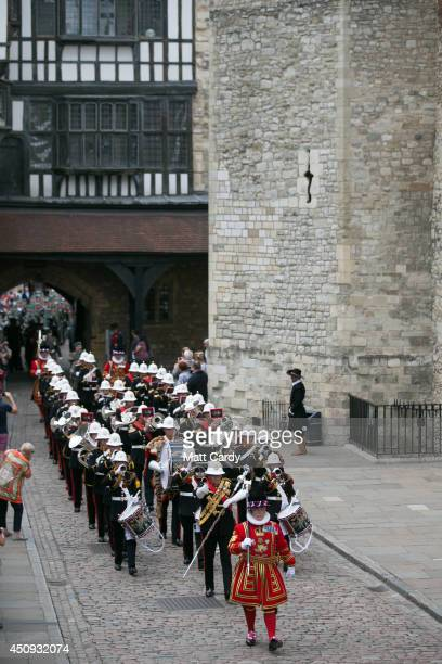 Yeoman Warders in State Dress and the Band of Her Majesty's Royal Marines Portsmouth escort Royal Marines and Royal Naval personnel from 1 Assault...