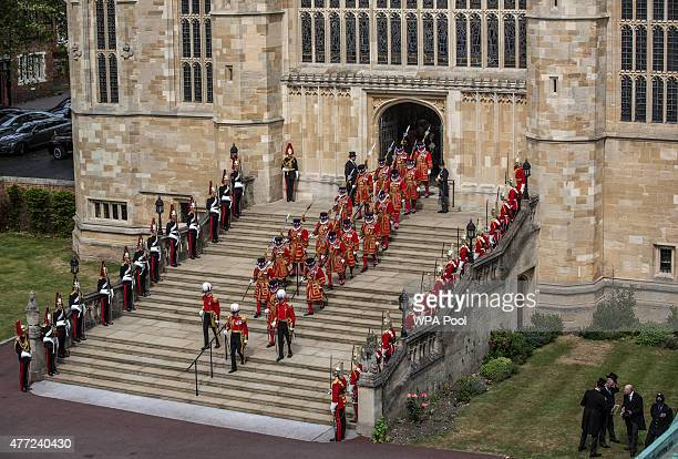 Yeoman warders march out of St George's chapel following the conclusion of the annual Order of the Garter Service at St George's Chapel in Windsor...