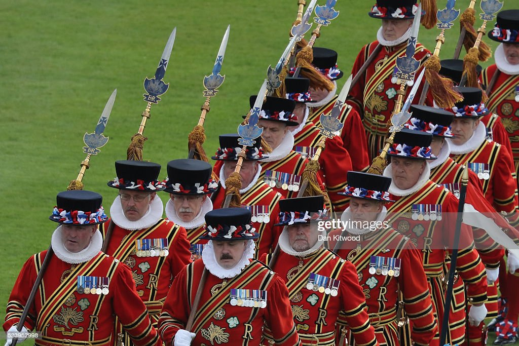 Yeoman Warders walk past guests attending a garden party at Buckingham Palace on May 24, 2016 in London, England.