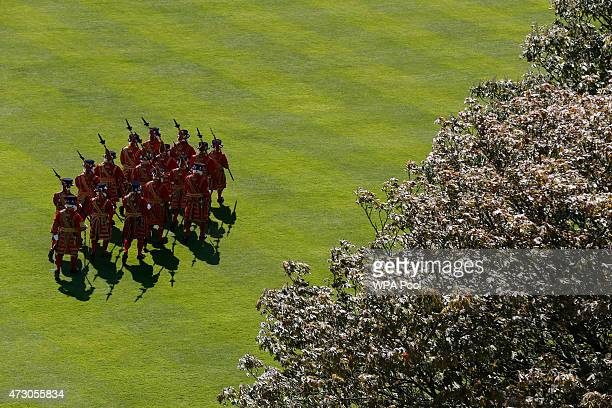 Yeomen of the Guard march during the Queen's garden party at Buckingham Palace on May 12 2015 in London Britain
