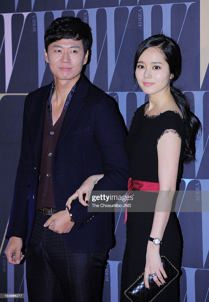 Yeon JungHoon and Han GaIn pose for photographs upon arrival duing the 7th Breast Cancer Campaign 'Love Your W' at Fradia on October 18 2012 in Seoul...