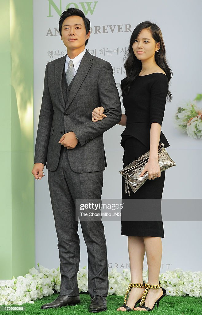 Yeon JungHoon and wife Han GaIn attend Lee ByungHun and Lee MinJung's wedding at Grand Hyatt Hotel on August 10 2013 in Seoul South Korea