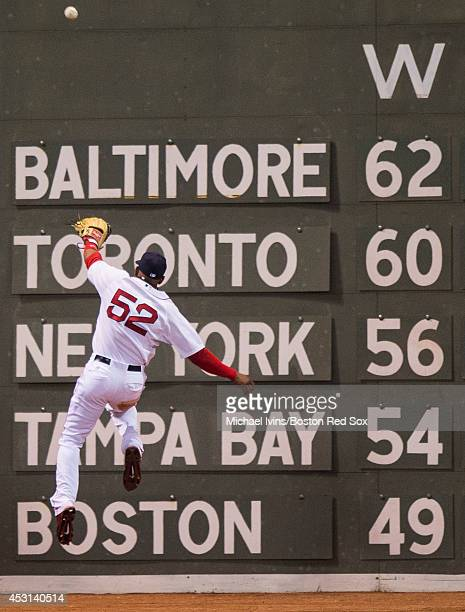 Yeonis Cespedes of the Boston Red Sox jumps but cannot reach a double off the bat of Chase Headley of the New York Yankees in the fifth inning on...