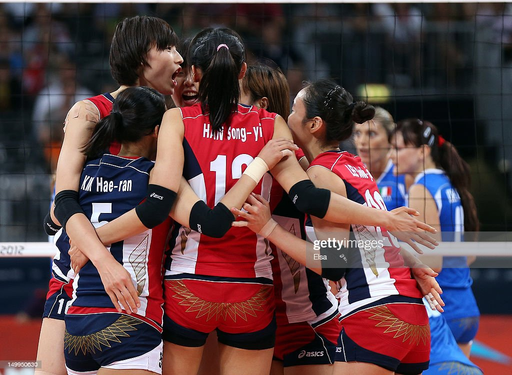 Yeon-Koung Kim #10 of Korea and the rest of her teammate celebrate after they won the third set against Italy during Women's Volleyball quarterfinals on Day 11 of the London 2012 Olympic Games at Earls Court on August 7, 2012 in London, England.