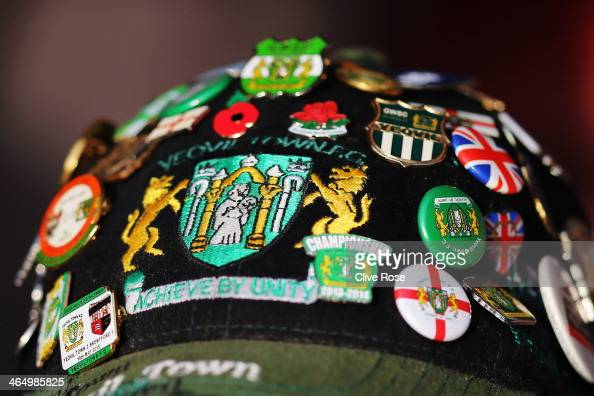 Yeovil fan wears a team cap emblazoned with badges during the FA Cup Fourth Round match between Southampton and Yeovil Town at St Mary's Stadium on...