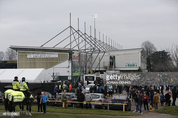 Yeovil fans stand outside the ground before the English FA Cup third round football match between Yeovil Town and Manchester United at Huish Park in...