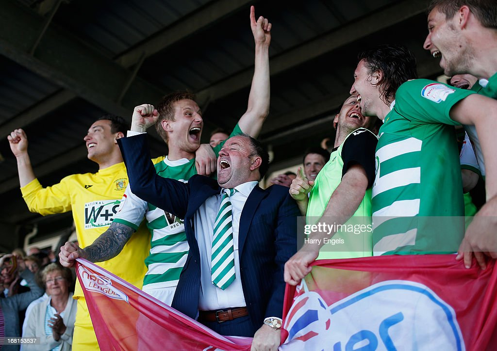 Yeovil Town manager Gary Johnson (C) celebrates with his players after winning the npower League One Play Off Semi Final second leg match between Yeovil Town and Sheffield United at Huish Park on May 6, 2013 in Yeovil, England.