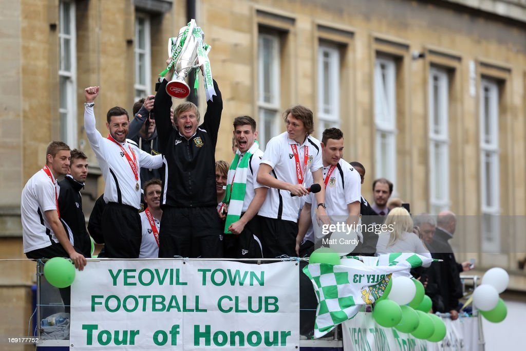 Yeovil Town players on board an opentop tour bus as they are seen during a celebration parade around the Somerset town on May 21 2013 in Yeovil...