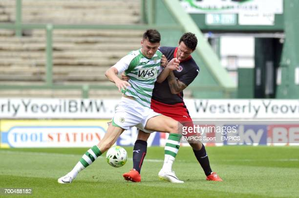 Yeovil Town's Kieffer Moore battles for the ball with Reading's Sean Morrison