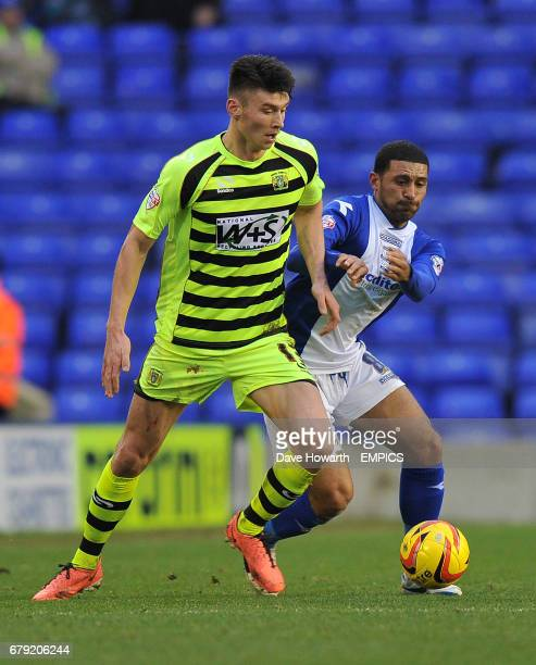 Yeovil Town's Kieffer Moore gets the better of Birmingham City's Hayden Mullins
