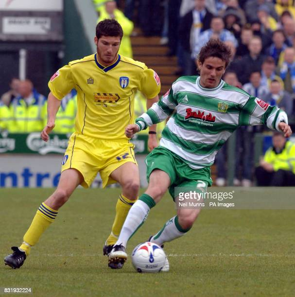 Yeovil's Chris Cohen battles for the ball with Colchester's Pat Baldwin during the CocaCola League One match at Huish Park Yeovil