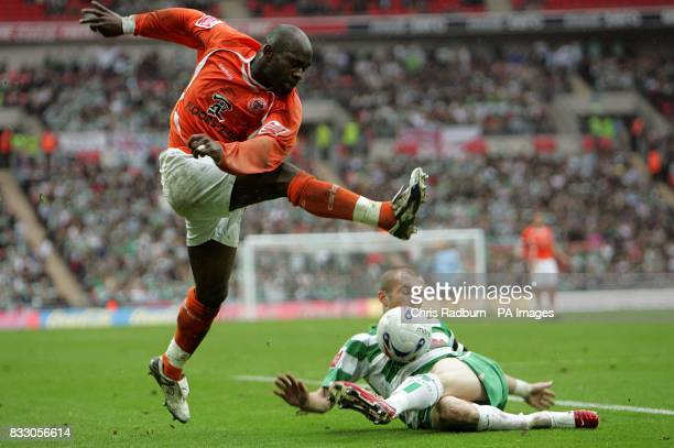 Yeovil's Nathan Jones slides in to win the ball from Blackpool's Adrian Forbes