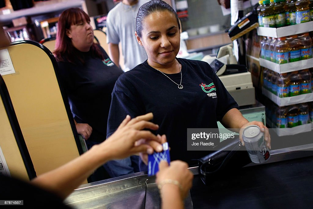 Yera Dominguez charges the credit card of Nicole Machado as she pays for items at Lorenzo's Italian Market on May 20, 2009 in Miami, Florida. Members of Congress today passed a bill placing new restrictions on companies that issues credit. The vote follows the Senate passage of the bill, which now heads for President Obama's promised signature. The bill will curb sudden interest rate increases and hidden fees, requiring card companies to tell customers of rate increases 45 days in advance. It will also make it harder for people aged below 21 to be issued credit cards.