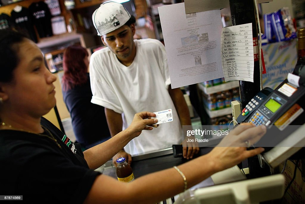 Yera Dominguez charges the credit card of Reynaldo Rodriguez as he pays for items at Lorenzo's Italian Market on May 20, 2009 in Miami, Florida. Members of Congress today passed a bill placing new restrictions on companies that issues credit. The vote follows the Senate passage of the bill, which now heads for President Obama's promised signature. The bill will curb sudden interest rate increases and hidden fees, requiring card companies to tell customers of rate increases 45 days in advance. It will also make it harder for people aged below 21 to be issued credit cards.