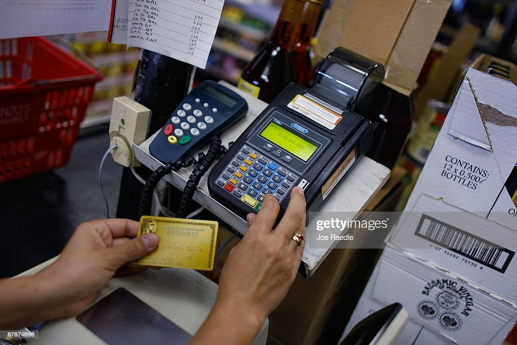 Yera Dominguez uses a credit card reader to charge a credit card from a customer for payment at Lorenzo's Italian Market on May 20, 2009 in Miami, Florida. Members of Congress today passed a bill placing new restrictions on companies that issues credit. The vote follows the Senate passage of the bill, which now heads for President Obama's promised signature. The bill will curb sudden interest rate increases and hidden fees, requiring card companies to tell customers of rate increases 45 days in advance. It will also make it harder for people aged below 21 to be issued credit cards.