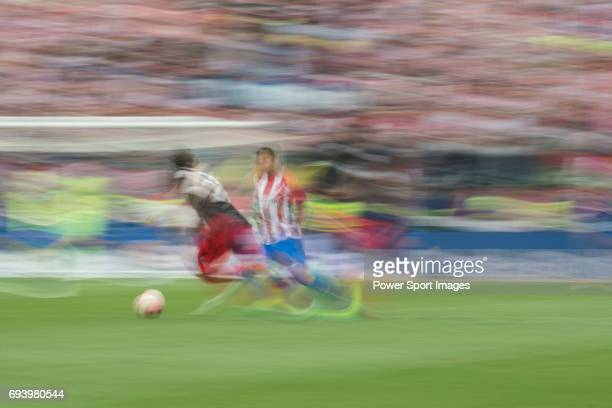 Yeray Alvarez Lopez of Athletic Club fights for the ball with Kevin Gameiro of Atletico de Madrid during the La Liga match between Atletico de Madrid...