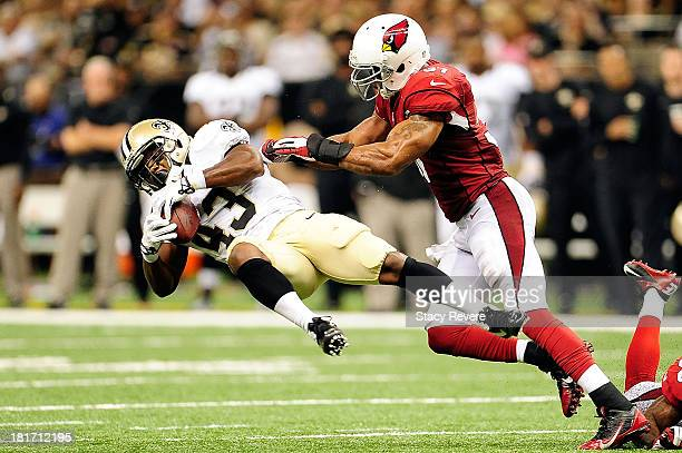 Yeremiah Bell of the Arizona Cardinals hits Darren Sproles of the New Orleans Saints during a game at the MercedesBenz Superdome on September 22 2013...