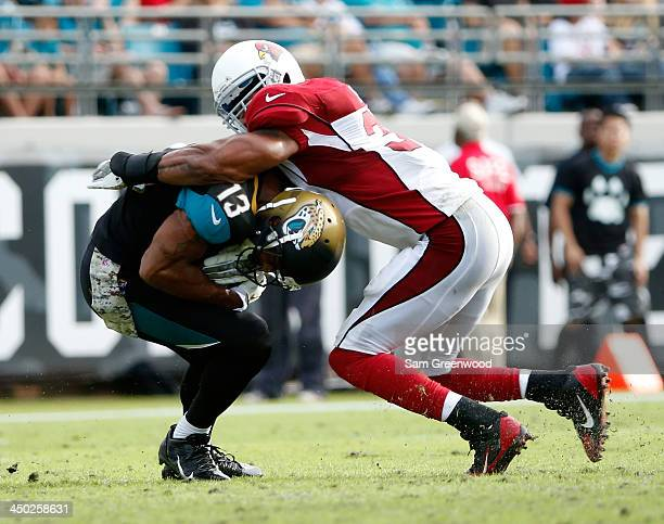 Yeremiah Bell of the Arizona Cardinals tackles Kerry Taylor of the Jacksonville Jaguars during the game at EverBank Field on November 17 2013 in...