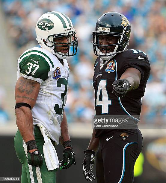 Yeremiah Bell of the New York Jets and Justin Blackmon of the Jacksonville Jaguars speak during the game at EverBank Field on December 9 2012 in...