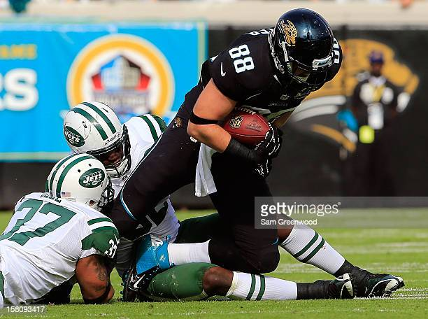 Yeremiah Bell of the New York Jets attempts to tackle Zach Potter of the Jacksonville Jaguars during the game at EverBank Field on December 9 2012 in...