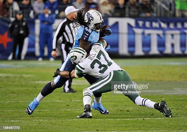 Yeremiah Bell of the New York Jets tackles Quinn Johnson of the Tennessee Titans at LP Field on December 17 2012 in Nashville Tennessee