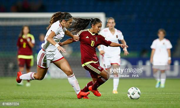 Yerliane Moreno of Venezuela is challenged by Berta Pujadas of Spain during the FIFA U17 Women's World Cup Third Place Play Off match between...