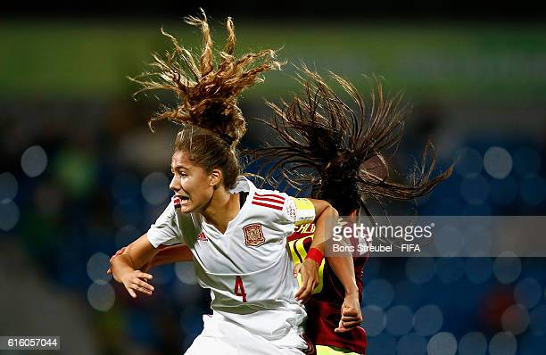 Yerliane Moreno of Venezuela jumps for a header with Laia Aleixandri of Spain during the FIFA U17 Women's World Cup Third Place Play Off match...