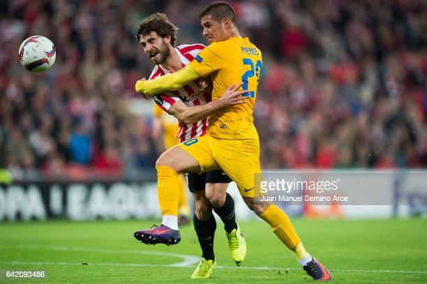 Yerran Alvarez of Athletic Club duels for the ball with Pieros Sotiriou of Apoel Nicosia FC during the UEFA Europa League Round of 32 first leg match...