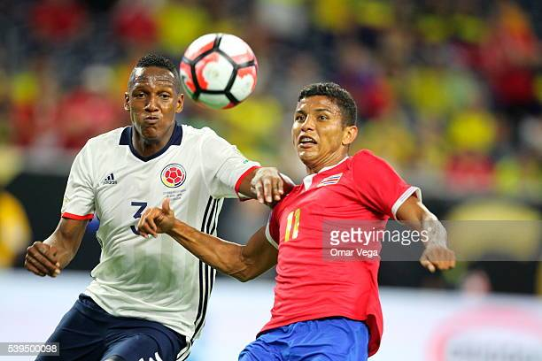 Yerri Mina of Colombia and Johan Venegas of Costa Rica fight for the ball during a group A match between Colombia and Costa Rica at NRG Stadium as...