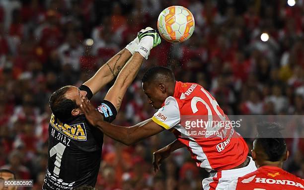 Yerri Mina of Colombia's Santa Fe vies for the ball with Marcos Diaz of Argentina's Huracan during their Sudamericana Cup final football match at El...