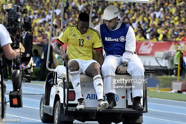 Yerry Mina of Colombia leaves the field injured during a match between Colombia and Chile as part of FIFA 2018 World Cup Qualifiers at Metropolitano...