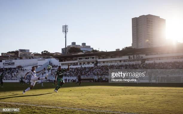 Yerry Mina of Palmeiras battles for the ball with Nino Paraiba of Ponte Preta during the match between Ponte Preta and Palmeiras as a part of...