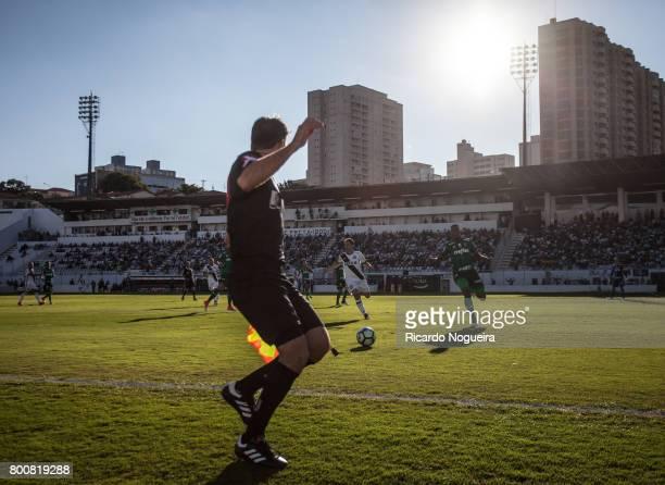 Yerry Mina of Palmeiras battles for the ball with Renato Caja of Ponte Preta during the match between Ponte Preta and Palmeiras as a part of...
