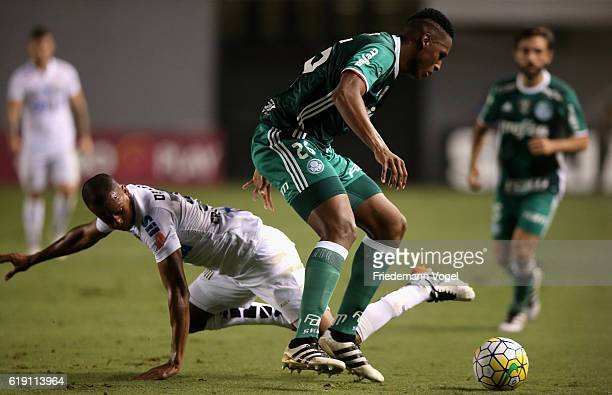 Yerry Mina of Palmeiras fights for the ball with Copete of Santos during the match between Santos and Palmeiras for the Brazilian Series A 2016 at...